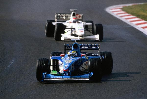 1999 European Grand Prix.Nurburgring, Germany. 24-26 September 1999.Giancarlo Fisichella (Benetton B199 Playlife) followed by Johnny Herbert (Stewart SF3 Ford).World Copyright - LAT Photographic