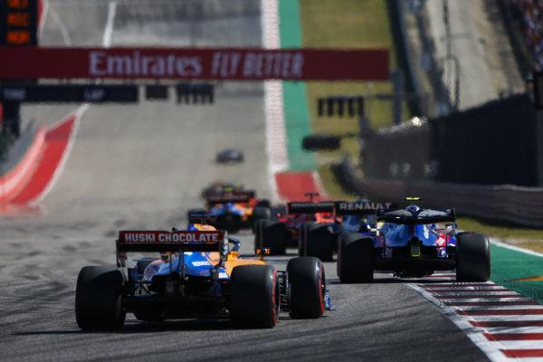 Pierre Gasly, Toro Rosso STR14, leads Carlos Sainz Jr., McLaren MCL34
