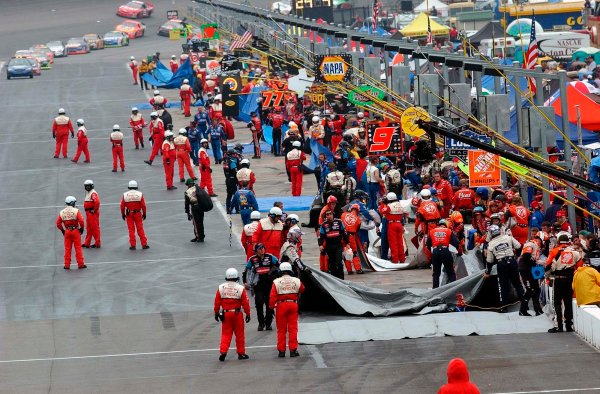 2002 NASCAR Atlanta Motor Speedway, October 25, 2002 NAPA 500/Aaron 's 312The cars make thier way down pit road under red flag conditions due to rain,-Robt LeSieur2002LAT Photographic