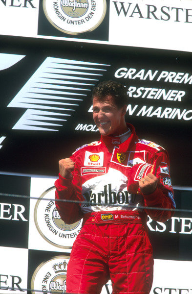1999 San Marino Grand Prix. Imola, Italy.  30/4-2/5 1999. Race winner Michael Schumacher (Ferrari) on the podium. Ref-99 SM 87. World Copyright - LAT Photographic