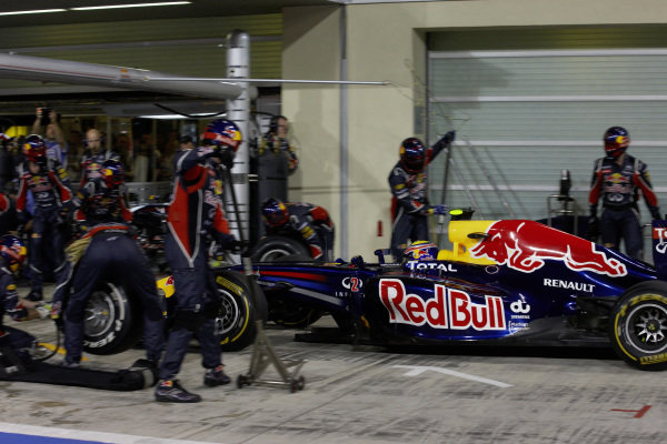 Mark Webber, Red Bull RB7 Renault, makes a pitstop.