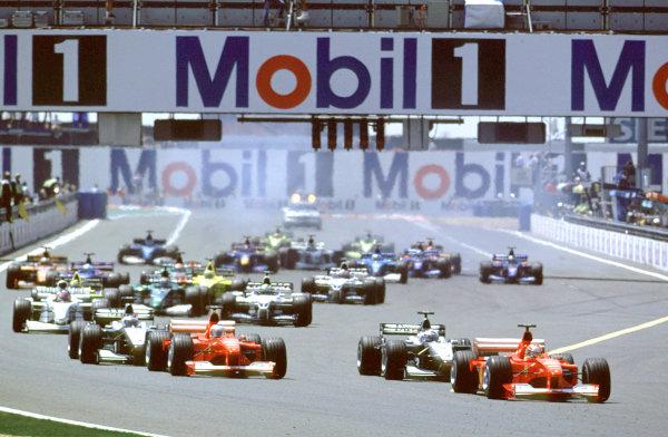 2000 French Grand Prix.Magny-Cours, France. 30/6-2/7 2000.Michael Schumacher (Ferrari F1-2000) leads David Coulthard (McLaren MP4/15 Mercedes), Rubens Barrichello (Ferrari F1-2000) and Mika Hakkinen (McLaren MP4/15 Mercedes) at the start.World Copyright - LAT PhotographicFormat: 35mm transparency