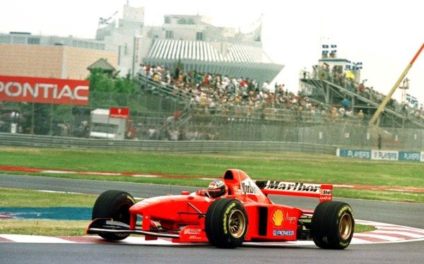 1997 Canadian Grand Prix.Montreal, Quebec, Canada.13-15 June 1997.Michael Schumacher (Ferrari F310B) 1st position at Island Hairpin. Casino in the background.World Copyright - LAT Photographic
