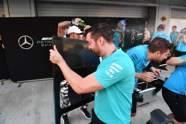 Race winner Lewis Hamilton, Mercedes AMG F1 celebrates with the champagne and the team