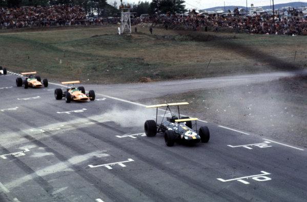 1968 United States Grand Prix.Watkins Glen, New York, USA.4-6 October 1968.Jochen Rindt (Brabham BT26 Repco) leads Denny Hulme and Dan Gurney (both McLaren M7A Ford).Ref: 68 USA 40.World Copyright - LAT Photographic
