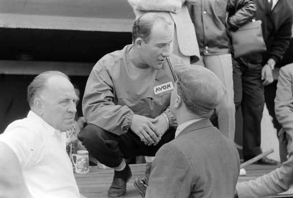 Stirling Moss chats with Colin Chapman.
