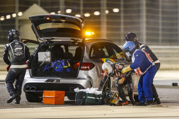 Medical delegates assist Romain Grosjean, Haas F1, after his huge first lap crash