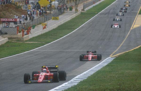 1990 Spanish Grand Prix.Jerez, Spain.28-30 September 1990.Alain Prost leads teammate Nigel Mansell (Ferrari 641) early on in the race.Ref-90 ESP 07.World Copyright - LAT Photographic