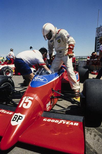 Alan Jones gets into his Lola THL-2 Ford.