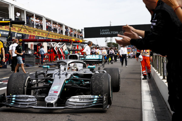 Race winner Lewis Hamilton, Mercedes AMG F1 W10 drives to Parc Ferme