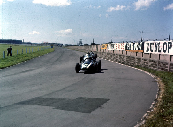 1959 British Grand Prix.Aintree, England.16-18 July 1959.Masten Gregory (Cooper T51 Climax) leads Roy Salvadori (Aston Martin DBR4/250) and Jo Bonnier (BRM P25). Salvadori and Gregory finished in 6th and 7th positions respectively.Ref-3/0103A.World Copyright - LAT Photographic