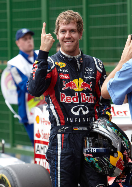 Interlagos, Sao Paulo, Brazil. 26th November 2011. Sebastian Vettel, Red Bull Racing RB7 Renault, celebrates pole in Parc Ferme. Portrait. Helmets.  World Copyright: Steve Etherington/LAT Photographic ref: Digital Image SNE27490