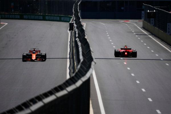Baku City Circuit, Baku, Azerbaijan. Friday 23 June 2017. Fernando Alonso, McLaren MCL32 Honda, and Kimi Raikkonen, Ferrari SF70H, drive down opposing sides of a carriageway. World Copyright: Andy Hone/LAT Images ref: Digital Image _ONY8634