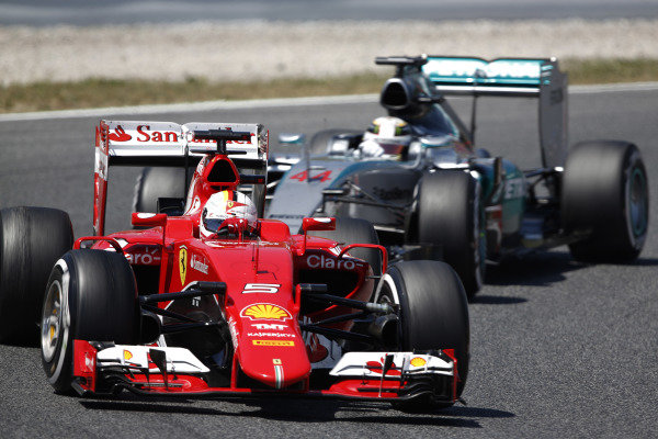 Circuit de Catalunya, Barcelona, Spain. Sunday 10 May 2015. Sebastian Vettel, Ferrari SF-15T, leads Lewis Hamilton, Mercedes F1 W06 Hybrid. World Copyright: Sam Bloxham/LAT Photographic. ref: Digital Image _SBL7727