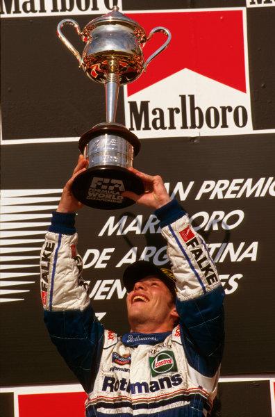 Buenos Aires, Argentina.11-13 APRIL 1997.Jacques Villeneuve (Williams FW19 Renault) celebrates 1st position on the podium.Ref-97 ARG 09.World Copyright - LAT Photographic