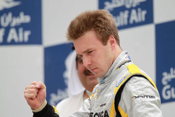 Bahrain International Circuit, Sakhir, Bahrain. 22nd April. Sunday Race.Davide Valsecchi (ITA, Dams) celebrates his victory on the podium.  World Copyright: Andrew Ferraro/GP2 Media Service. Ref: Digital Image _Q0C8529.jpg