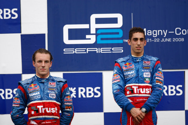 Magny-Cours, France. 22nd June.Sunday Race. Sebastien Buemi (SUI, Trust Team Arden) celebrates his victory on the podium with Yelmer Buurman (NED, Trust Team Arden). World Copyright: Andrew Ferraro/GP2 Series Media Service.ref: Digital Image _H0Y8056