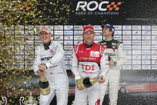 L-R: Michael Schumacher (GER) (seven-time Formula 1 World Champion), Team Germany, celebrates Team Germany's fifth ROC Nations Cup win together with runner-ups Tom Kristensen (DEN(, (eight-time Le Mans 24-Hour race winner), Team Nordic, and Juho Hanninen (FIN), (2011 S-WRC champion and 2010 IRC champion), Team Nordic.Race of Champions, Esprit Arena, Dusseldorf, Germany, 3-4 December 2011.