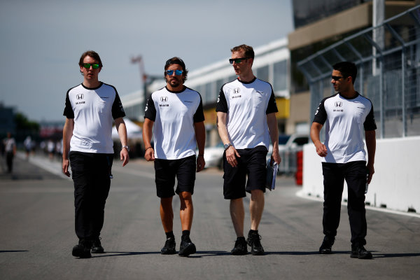 Circuit Gilles Villeneuve, Montreal, Canada. Thursday 4 June 2015. Fernando Alonso, McLaren walks the track with his team. World Copyright: Andy Hone/LAT Photographic. ref: Digital Image _ONZ1374