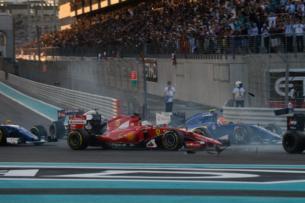 Pastor Maldonado (VEN) Lotus E23 Hybrid and Fernando Alonso (ESP) McLaren MP4-30 collide at the start of the race at Formula One World Championship, Rd19, Abu Dhabi Grand Prix, Race, Yas Marina Circuit, Abu Dhabi, UAE, Sunday 29 November 2015.