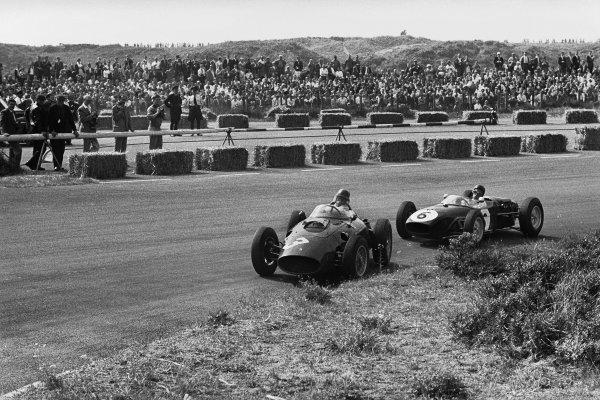 Zandvoort, Holland.4-6 June 1960.Richie Ginther (Ferrari Dino 246) 6th position, leads Jim Clark (Lotus 18-Climax), retired, action.World Copyright: LAT PhotographicRef: 8660 - 22A/23