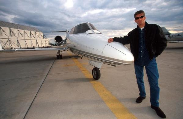Damon Hill (GBR) with the Lear Jet that he uses to fly to the races.  Home Feature, Dublin, Eire, 12 October 1998.