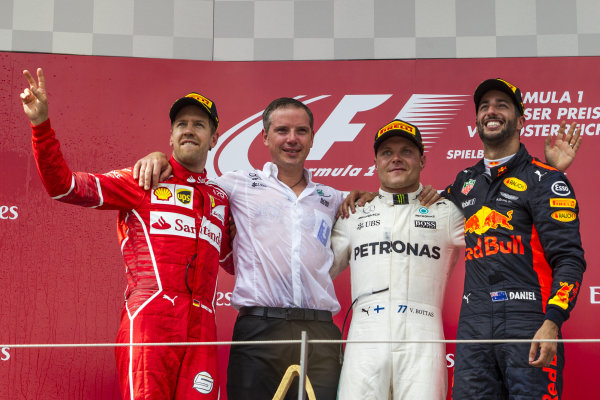 Sebastian Vettel (GER) Ferrari, Valtteri Bottas (FIN) Mercedes AMG F1 and Daniel Ricciardo (AUS) Red Bull Racing celebrate on the podium at Formula One World Championship, Rd9, Austrian Grand Prix, Race, Spielberg, Austria, Sunday 9 July 2017.