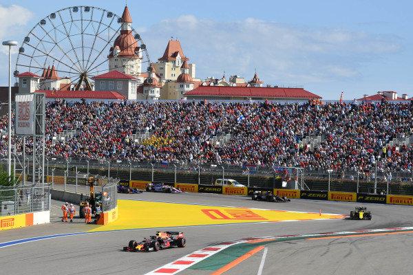 Max Verstappen, Red Bull Racing RB15, leads Nico Hulkenberg, Renault R.S. 19, and Kevin Magnussen, Haas VF-19