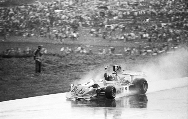 1975 Austrian Grand Prix.Osterreichring, Zeltweg, Austria.15-17 August 1975.Vittorio Brambilla (March 751 Ford) celebrates his 1st position and maiden Grand Prix win. The front of his car is damaged because after seeing the chequered flag he raised his arms in jubilation, whereby he crashed into the barriers, but was still able to continue driving.World Copyright - LAT Photographic