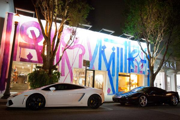 A Lamborghini and a Ferrari in the street