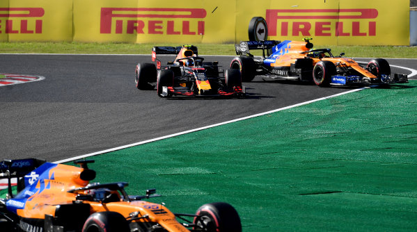 Carlos Sainz Jr., McLaren MCL34, leads Alexander Albon, Red Bull RB15, and Lando Norris, McLaren MCL34