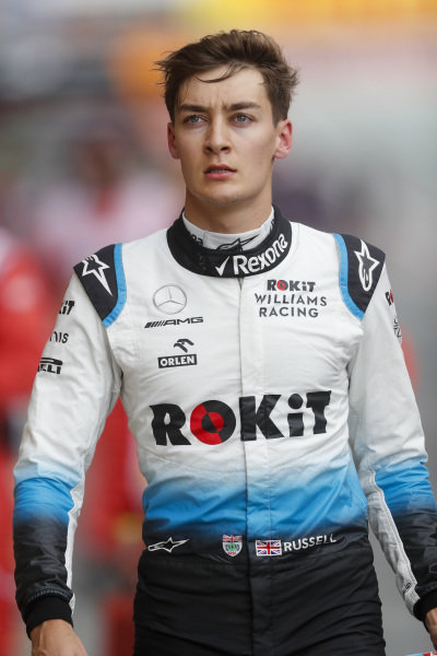 George Russell, Williams Racing walks back to the garage after crashing in FP3