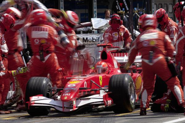Michael Schumacher, Ferrari 248 F1 comes in for a pitstop.