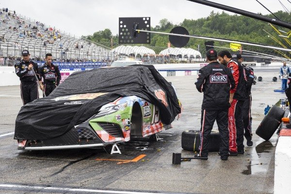 #19: Martin Truex Jr., Joe Gibbs Racing, Toyota Camry Resers Fine Foods #LetsPicnic crew looks at his car under the red flag