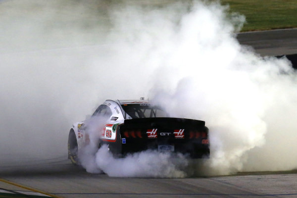 #00: Cole Custer, Stewart-Haas Racing, Ford Mustang Haas Automation celebrates his win with a burnout