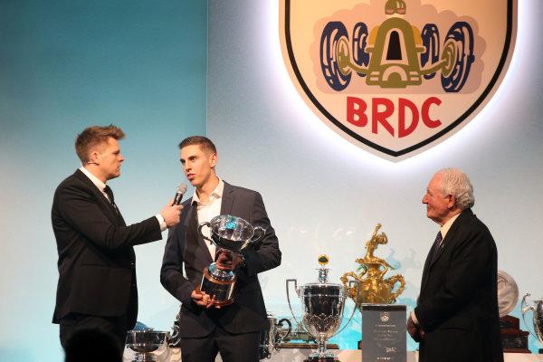 2017 British Racing Drivers Club Awards. London Hilton Hotel, Park Lane, London. Monday 4th December 2017. Paddy Hopkirk presents the Graham Hill Trophy to Harrison Scott. World Copyright: Jakob Ebrey / LAT Images. Ref: Scott_02