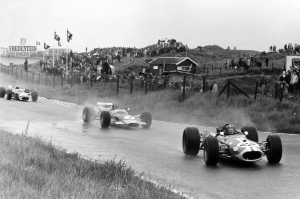 1968 Dutch Grand Prix.Zandvoort, Holland. 23 June 1968.Silvio Moser, Brabham BT20-Repco, 5th position, leads Graham Hill, Lotus 49B-Ford, 9th position, and Jo Siffert, Lotus 49-Ford, retired, action.World Copyright: LAT PhotographicRef: Motor b&w print