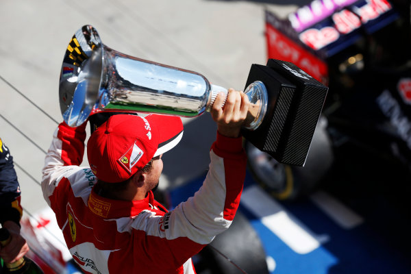 Hungaroring, Budapest, Hungary. Sunday 26 July 2015. Sebastian Vettel, Ferrari, 1st Position, with his trophy. World Copyright: Alastair Staley/LAT Photographic ref: Digital Image _79P0998