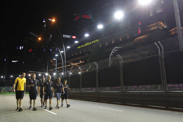 Marina Bay Circuit, Singapore. Thursday 19th September 2013. Sebastian Vettel, Red Bull Racing walks the track with his team. World Copyright: Andy Hone/LAT Photographic. ref: Digital Image HONY9120