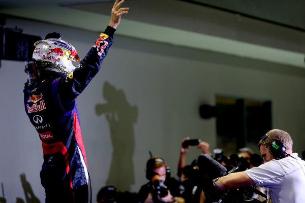 Marina Bay Circuit, Singapore. Sunday 22nd September 2013.  Sebastian Vettel, Red Bull Racing, celebrates in parc ferme.  World Copyright: Andy Hone/LAT Photographic. ref: Digital Image HONZ5911