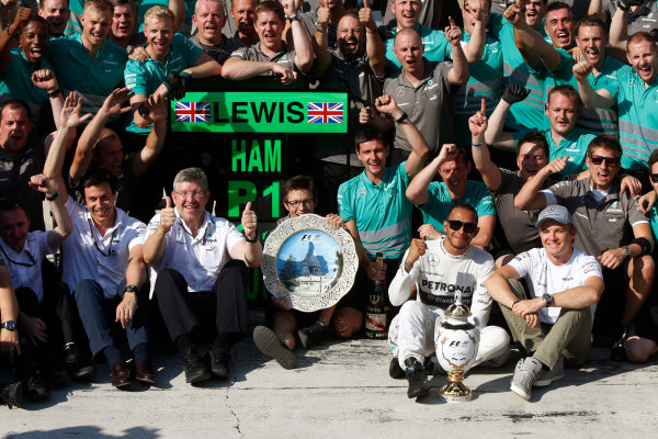 Hungaroring, Budapest, Hungary 28th July 2013 Lewis Hamilton, Mercedes AMG, 1st position, celebrates with his team World Copyright: Charles Coates/LAT Photographic ref: Digital Image _N7T3997