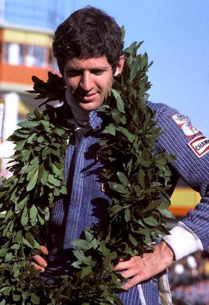Jody Scheckter (RSA) celebrates a historic victory in the opening race of the season, as the Wolf team he drove for became the first and only constructor to win on their GP debut.Argentinean Grand Prix, Rd1, Buenos Aires No. 15, Argentina, 9 January 1977.BEST IMAGE
