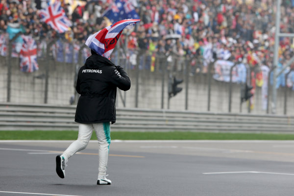 Shanghai International Circuit, Shanghai, China.  Friday 07 April 2017.  Lewis Hamilton, Mercedes AMG, takes to the track to entertain the fans and picks up a Union Flag. World Copyright: Charles Coates/LAT Images  ref: Digital Image AN7T4866