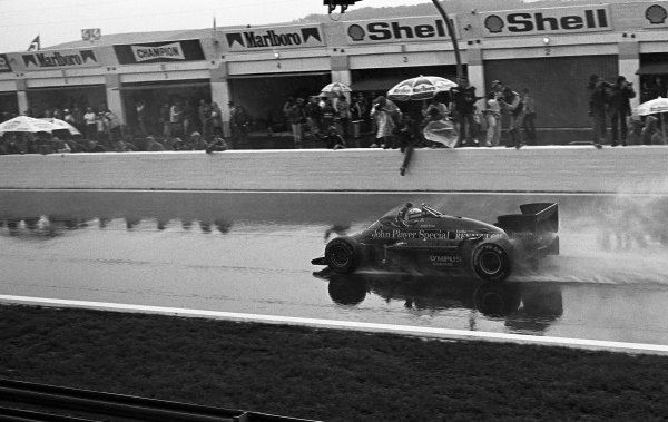 Ayrton Senna (BRA) Lotus 97T crosses the line to win his first Grand Prix. Formula One World Championship, Rd2, Portuguese Grand Prix, Estoril, Portugal, 21 April 1985.