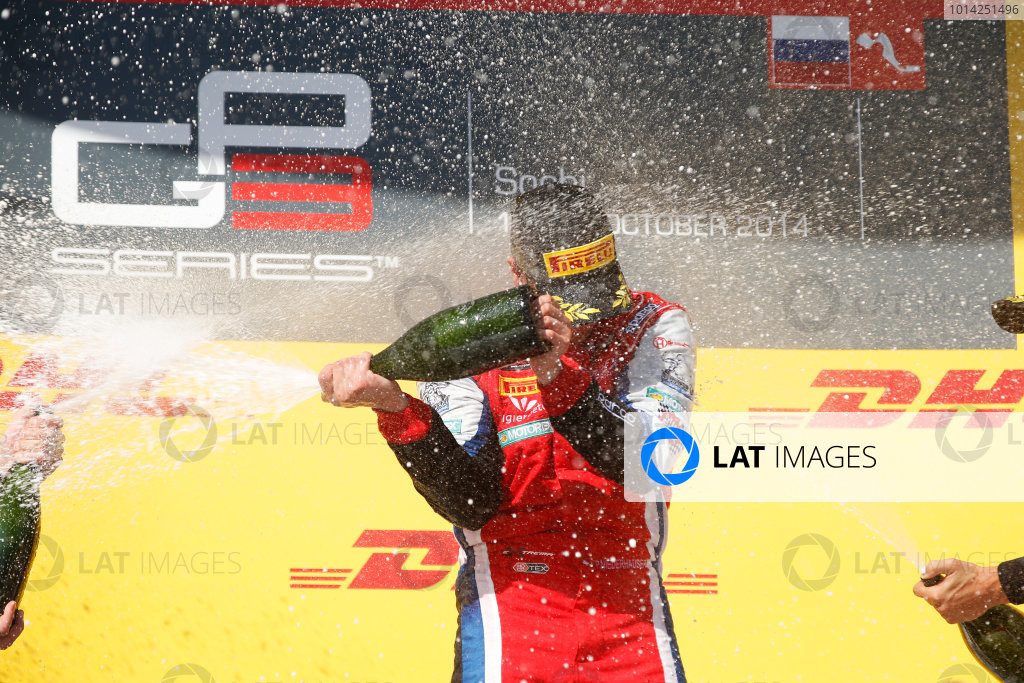 2014 GP3 Series. Round 8.   Sochi Autodrom, Sochi, Russia. Sunday Race 2 Sunday 12 October 2014. Patric Niederhauser (SUI, Arden International) sprays the champagne on the podium. Photo: Glenn Dunbar/GP3 Series Media Service. ref: Digital Image _89P3017