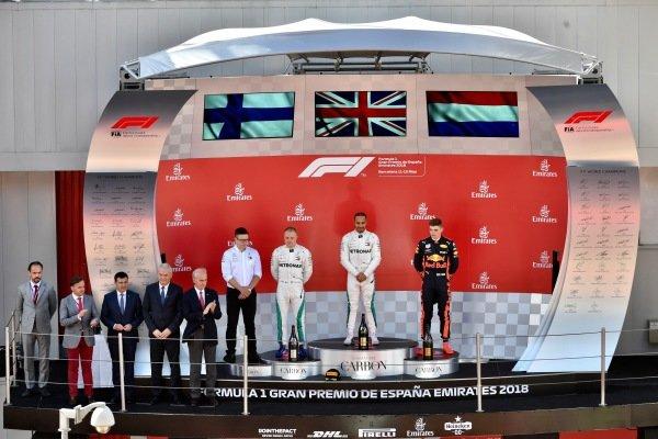 (L to R): Bonnington (GBR) Mercedes AMG F1 Race Engineer, Valtteri Bottas (FIN) Mercedes-AMG F1, Lewis Hamilton (GBR) Mercedes-AMG F1 and Max Verstappen (NED) Red Bull Racing on the podium
