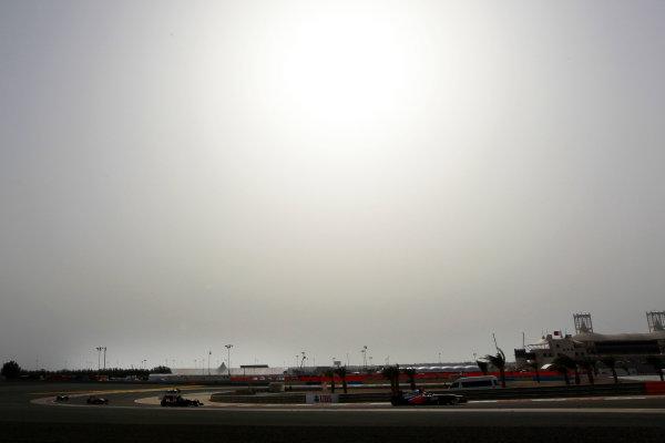 Bahrain International Circuit, Sakhir, Bahrain Sunday 21st April 2013 Jenson Button, McLaren MP4-28 Mercedes, leads Romain Grosjean, Lotus E21 Renault.  World Copyright: Andy Hone/LAT Photographic ref: Digital Image HONY1521