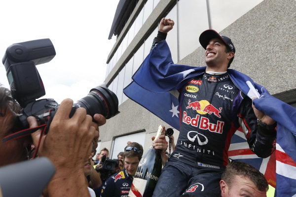 Circuit Gilles Villeneuve, Montreal, Canada. Sunday 8 June 2014. Daniel Ricciardo, Red Bull Racing, 1st Position, celebrates with his team. World Copyright: Alastair Staley/LAT Photographic. ref: Digital Image _79P1310