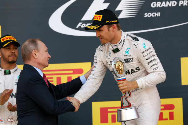 Sochi Autodrom, Sochi, Russia. Sunday 1 May 2016. Nico Rosberg, Mercedes AMG, 1st Position, receives his trophy from Russian President Vladimir Putin. World Copyright: Sam Bloxham/LAT Photographic ref: Digital Image _R6T6625