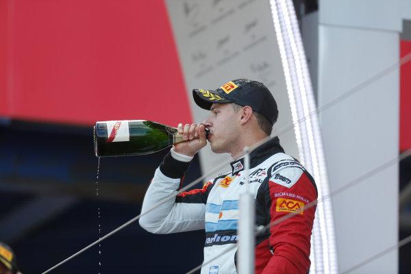 2013 GP3 Series. Round 4.  Nurburgring, Germany.  6th July 2013.  Saturday Race. Facu Regalia (ARG, ART Grand Prix) celebrates his victory on the podium.  World Copyright: Andrew Ferraro/GP2 Series Media Service. Ref: _79P5814